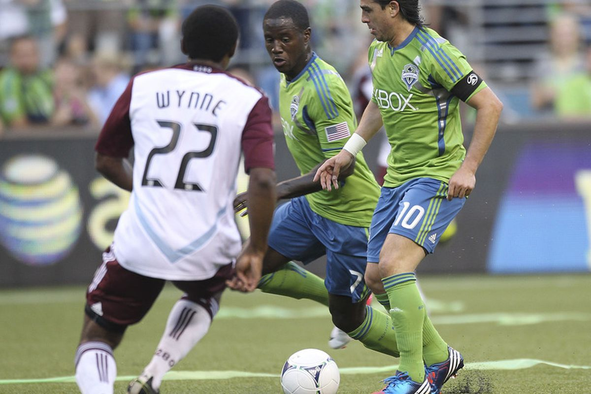 SEATTLE, WA - JULY 07:  Mauro Rosales #10 and Eddie Johnson #7 of the Seattle Sounders battle Marvell Wynne #22 of the Colorado Rapids at CenturyLink Field on July 7, 2012 in Seattle, Washington. (Photo by Otto Greule Jr/Getty Images)