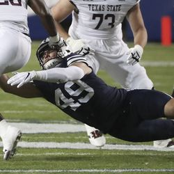 Brigham Young Cougars linebacker Payton Wilgar (49) tries to make a tackle in Provo on Saturday, Oct. 24, 2020.