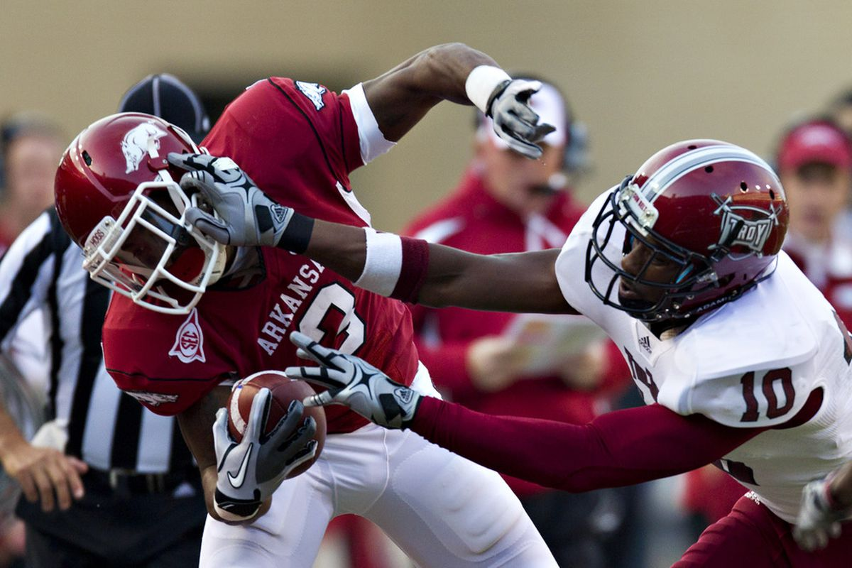 Joe Adams gets pushed out of bounds by Brynden Trawick during Saturday's game against the Troy Trojans (Photo by Wesley Hitt/Getty Images).