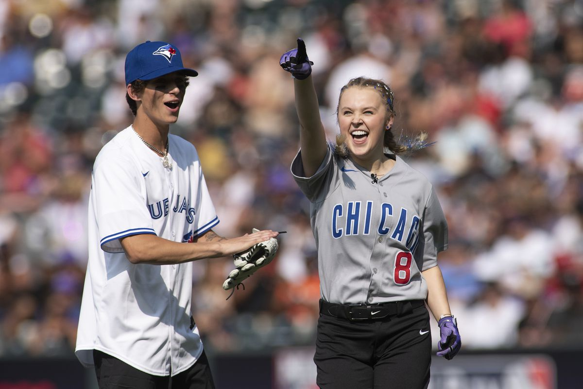Social media Influencer Josh Richards (left) is photographed with media personality JoJo Siwa during the MLB All-Star Celebrity Softball Game at Coors Field on July 11, 2021 in Denver, Colorado.
