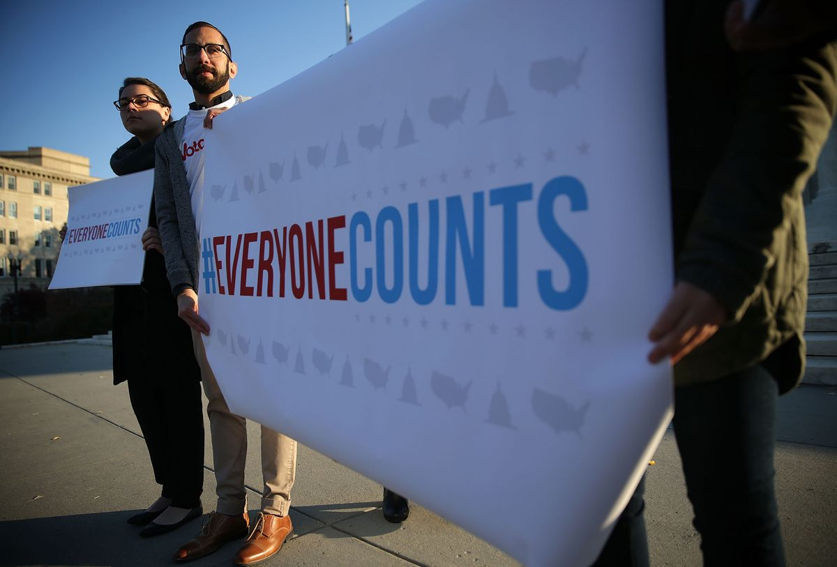 "Activists hold an ""#EVERYONECOUNTS"" banner in support of states allocating seats in Congress based on total population, not just citizens. The 2020 census could open the door to states, or the federal government, to change that."