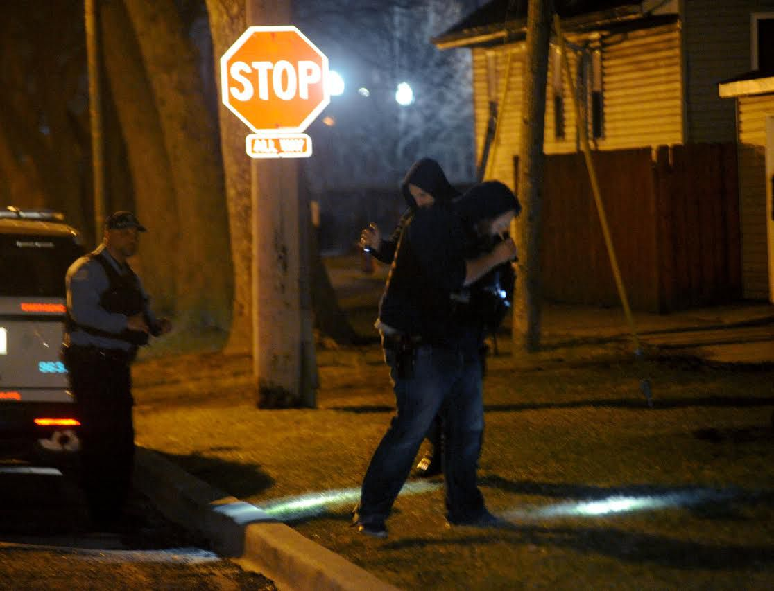 Police investigate the scene of a shooting in Gresham on March 28. | Justin Jackson/ Sun-Times