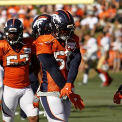 ILB Von Miller gets down with his dance moves between drills at training camp.