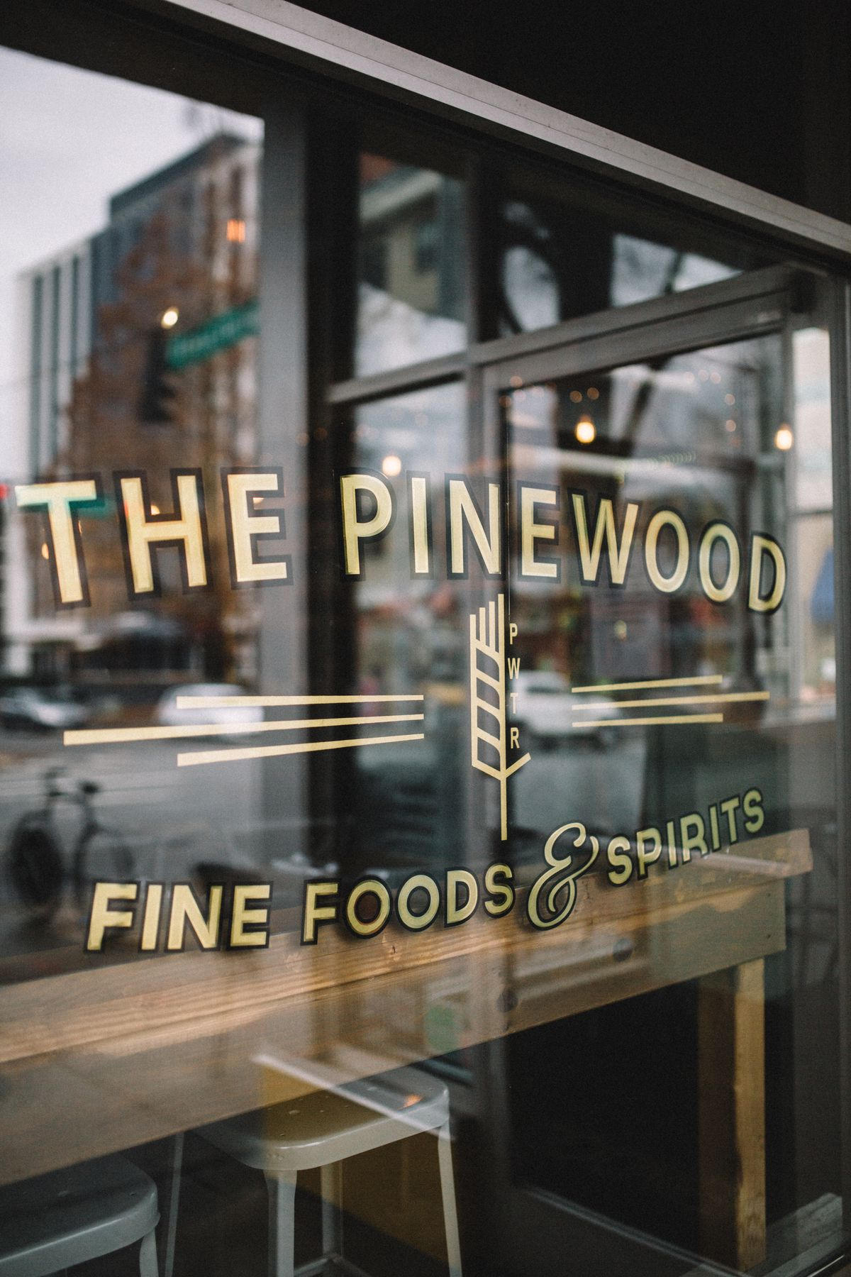 Window signage at The Pinewood.