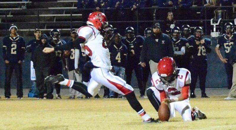 Harrison Wilkerson kick football