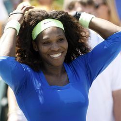 Serena Williams smiles after defeating Lucie Safarova, of the Czech Republic, during their finals match at the Family Circle Cup tennis tournament in Charleston, S.C., Sunday, April 8, 2012. Williams won 6-0, 6-1.