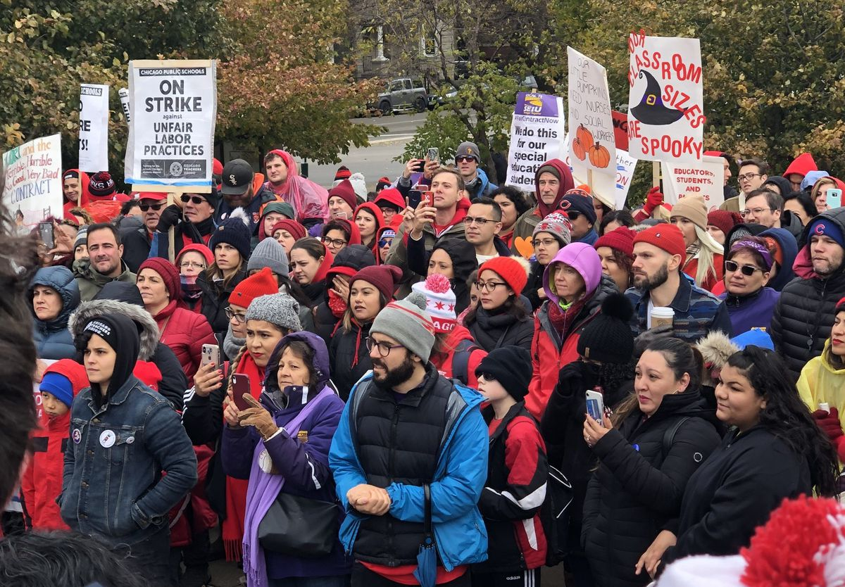 Parents and teachers fill a park in Logan Square for a rally supporting striking teachers on Oct. 22, 2019.