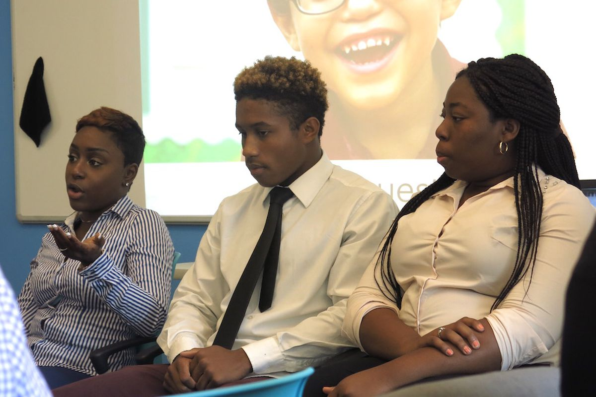 In 2015 RoBrean Black, Marquis Wilson and Avril Gordon, students from Achievement First's inaugural graduating class, discussed their transition to college at the network's board meeting.