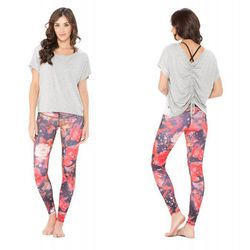 """Our pick: This casual tee is perfect for post-workout errands. Versa tee in heather, $54 at <a href=""""http://www.bodylanguagesportswear.com/shop/tops/versa-tee.html"""">Body Language Sportswear</a>"""
