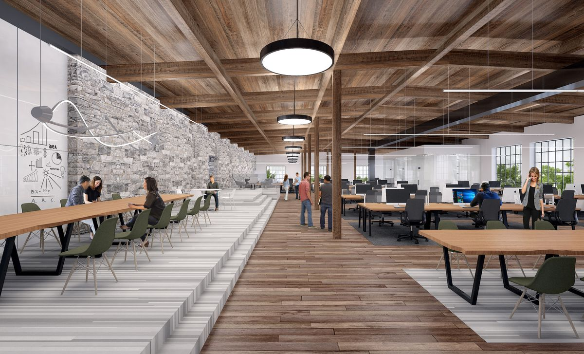 A rendering shows what could become of the former mill's interior, with wood framing and an open floor plan.