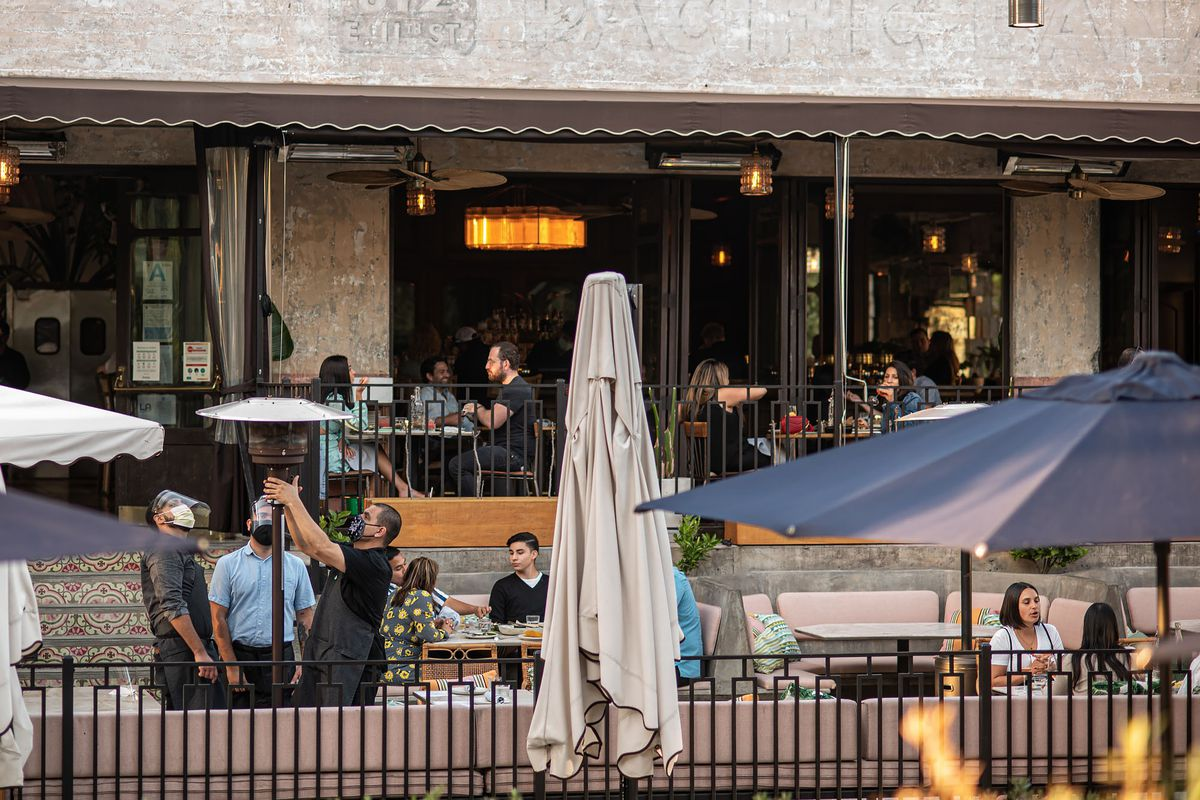 Outdoor dining patio at Dama in Arts District, Los Angeles