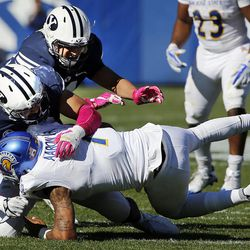 San Jose State Spartans quarterback Montel Aaron is sacked by Brigham Young Cougars defensive lineman Sione Takitaki during NCAA football in Provo on Saturday, Oct. 28, 2017.