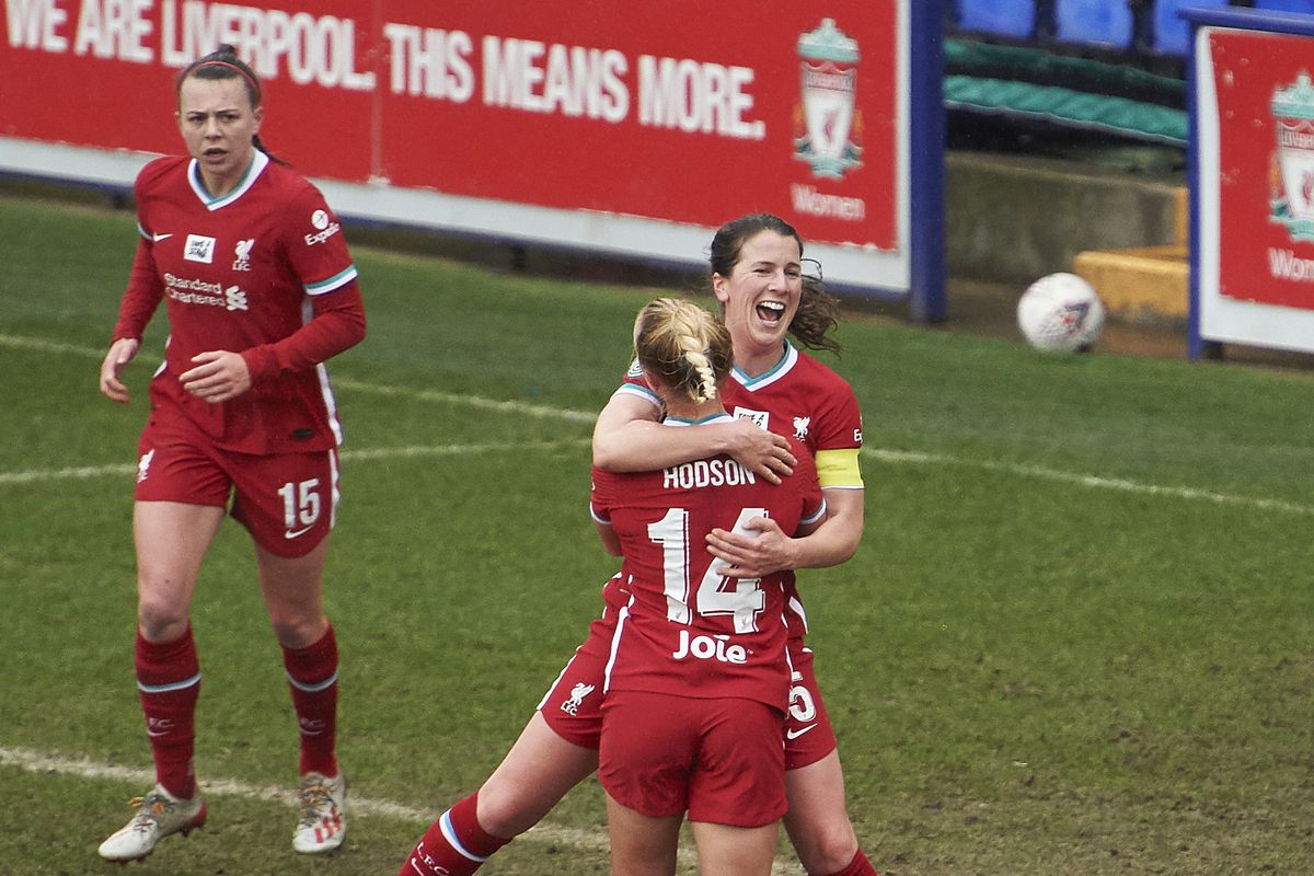 Niamh Fahey of Liverpool Women celebrates scoring Liverpool's first goal with Ashley Hodson (14) at Prenton Park on March 14, 2021 in Birkenhead, England.