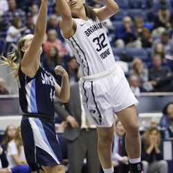 Brigham Young Cougars forward Kalani Purcell (32) drives on San Diego Toreros forward Sydney Williams (44) in Provo Thursday, Feb. 18, 2016. BYU won 68-60 to clinch the West Coast Conference championship.