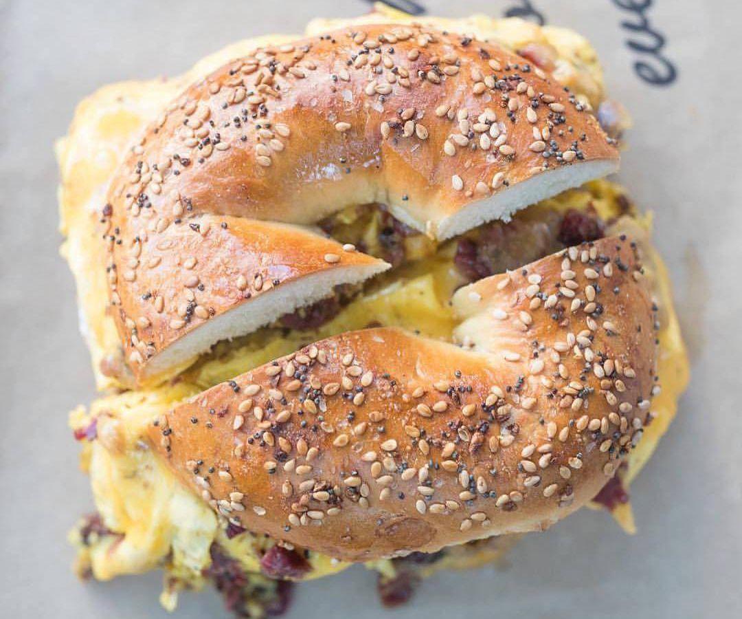 A bagel sandwich cut in half.