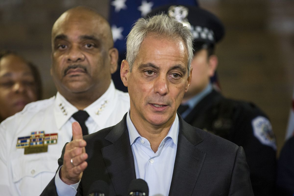 Chicago Police Supt. Eddie Johnson looks on as Mayor Rahm Emanuel speaks during a press conference at the city's 11th District police station, Wednesday morning, Oct. 24, 2018.