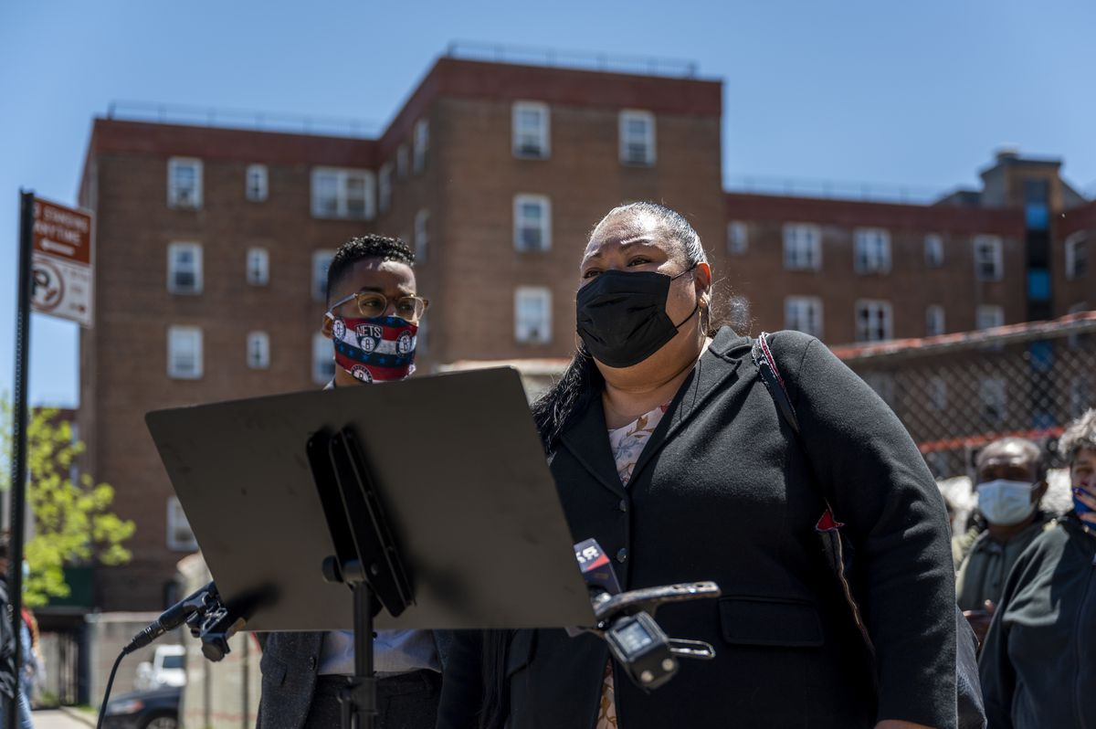 Assemblymember Marcela Mitaynes addresses the media gathered at the edge of the Red Hook Houses during a news conference on ongoing gas outages.