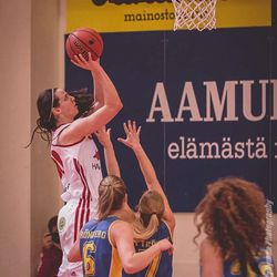 Jessica Schroll goes up for a bucket while playing for Pyrinto, a professional women's basketball team in Finland, this past winter.