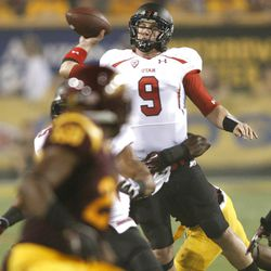Utah Utes quarterback Jon Hays (9) is hit while trying to throw the ball as the Univeristy of Utah and Arizona State University play PAC 12 football Saturday, Sept. 22, 2012, in Tempe, Arizona.
