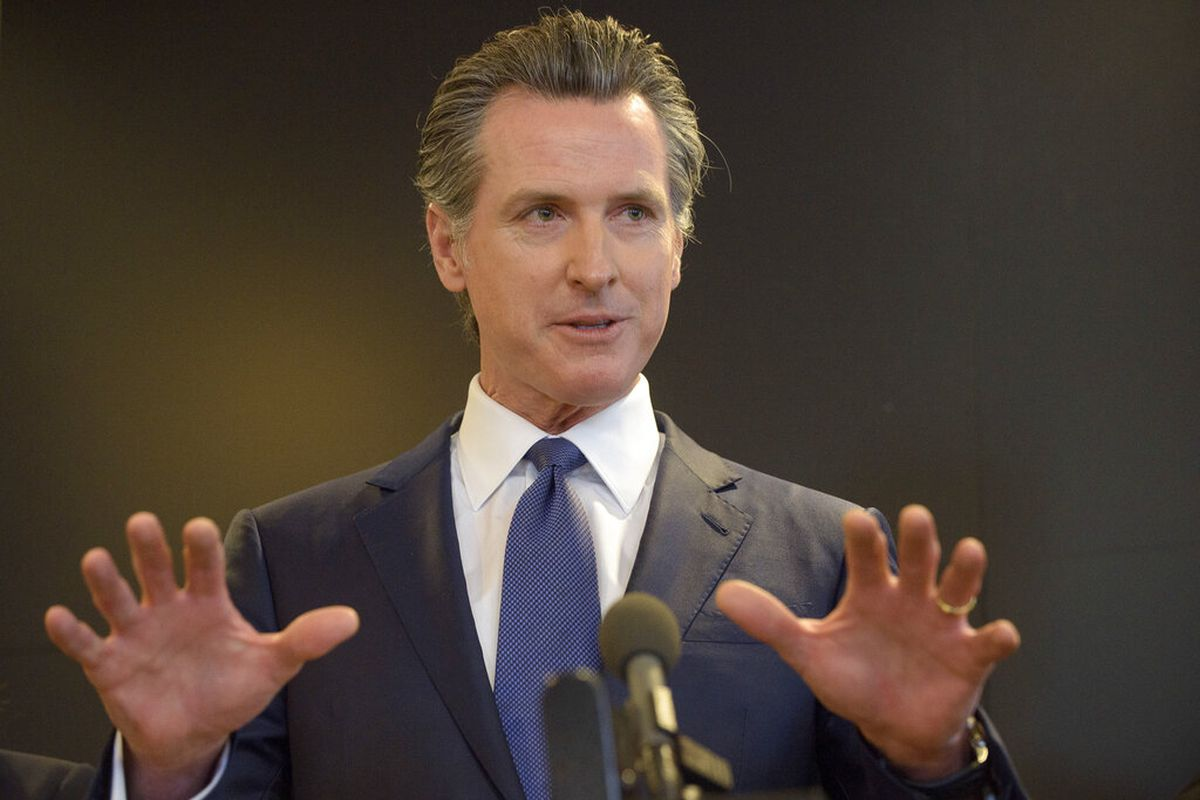 California Governor Gavin Newsom speaks to members of the press at a news conference in Sacramento, Calif.