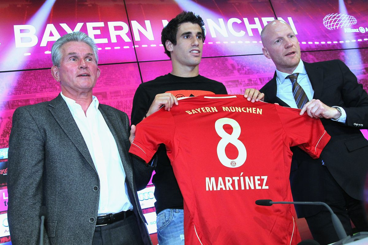 MUNICH, GERMANY - AUGUST 30:  Javi Martinez (C) presents his new Bayern Munich number alongside head coach Jupp Heynckes (L) and sport director Matthias Sammer during a press conference at Allianz Arena on August 30, 2012 in Munich, Germany.