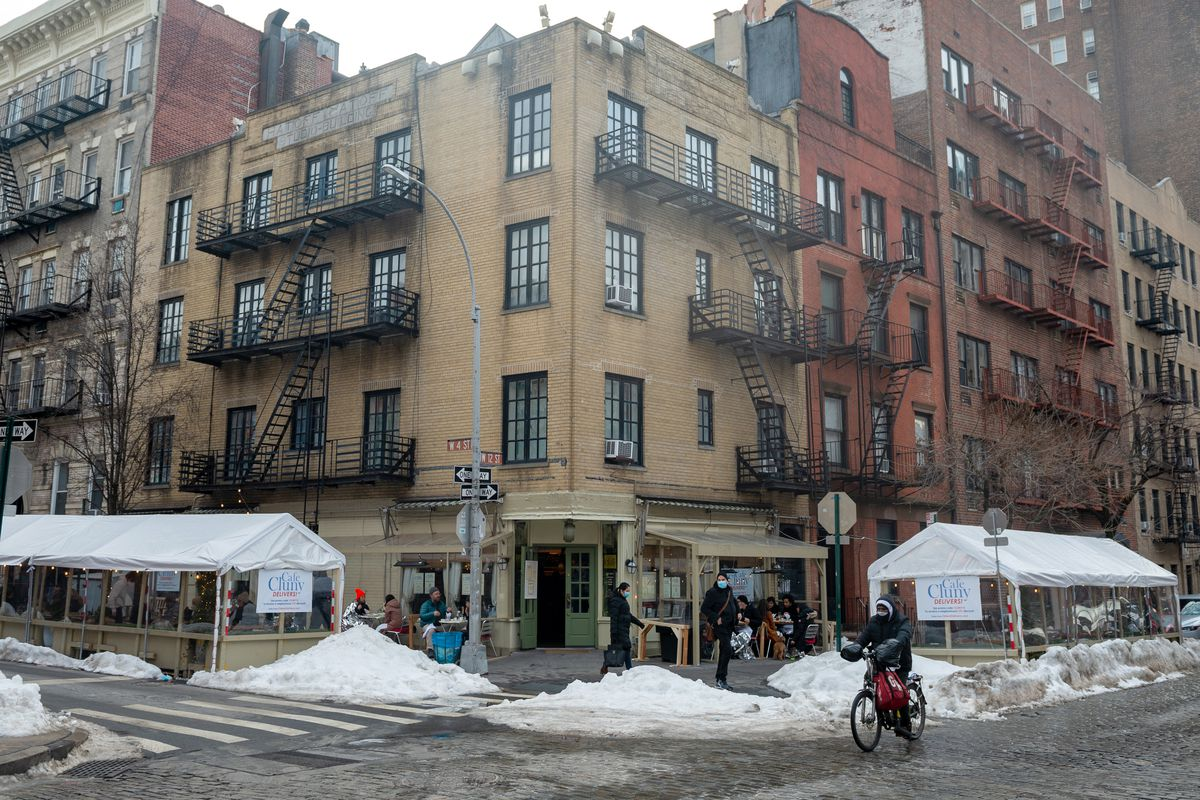 A view of Cafe Cluny's outdoor dining tents surrounding residential buildings in the West Village on February 14, 2021 in New York City.