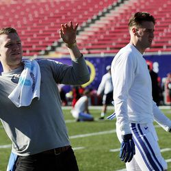 Brigham Young's Taysom Hill throws some passes before the Royal Purple Las Vegas Bowl, Saturday, Dec. 19, 2015. At right are Mitch Mathews and Tanner Mangum of BYU.