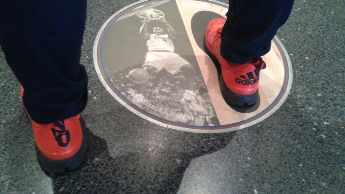 Me in my red Damian Lillard signature shoes compared to Shaq's massive footprint.