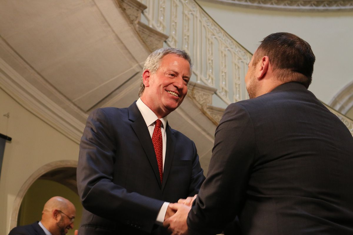 Mayor Bill de Blasio and City Council Speaker Corey Johnson reached a handshake agreement on the city's budget Friday.