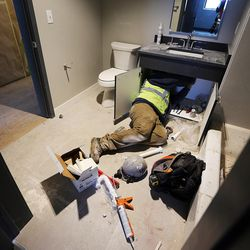 Fernando Jimenez installs a bathroom sink in Salt Lake City on Thursday, Feb. 2, 2017, during construction of the 9th East Lofts at Bennion Plaza. The building will provide 68 affordable apartments.