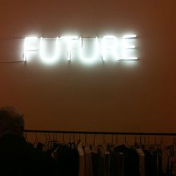 One-word neon signs are mounted on the walls