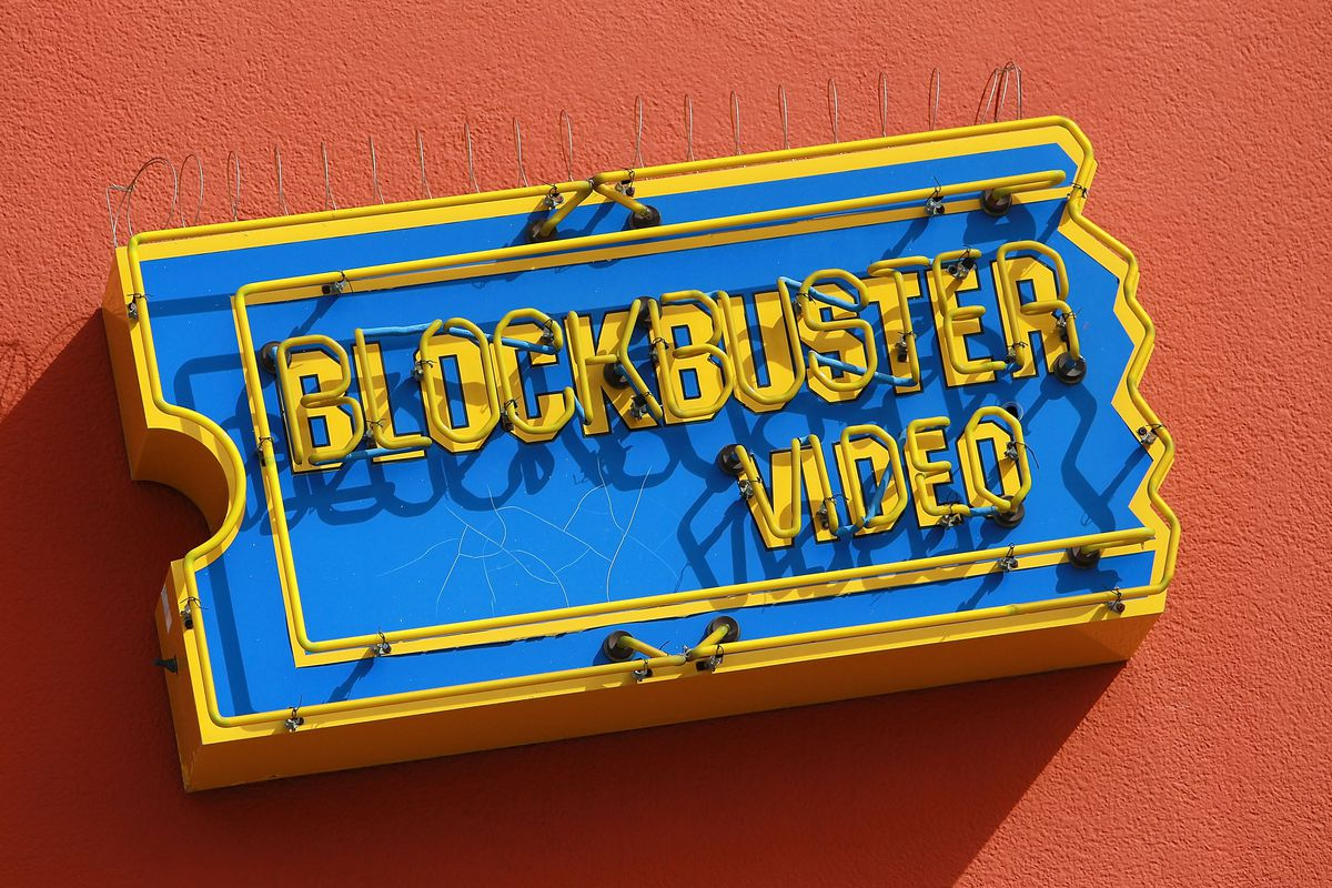 A Blockbuster Video sign on the side of a building.