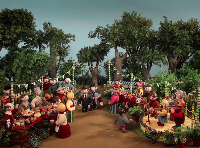 """The village green in Radiohead's """"Burn the Witch,"""" decked out for a party"""