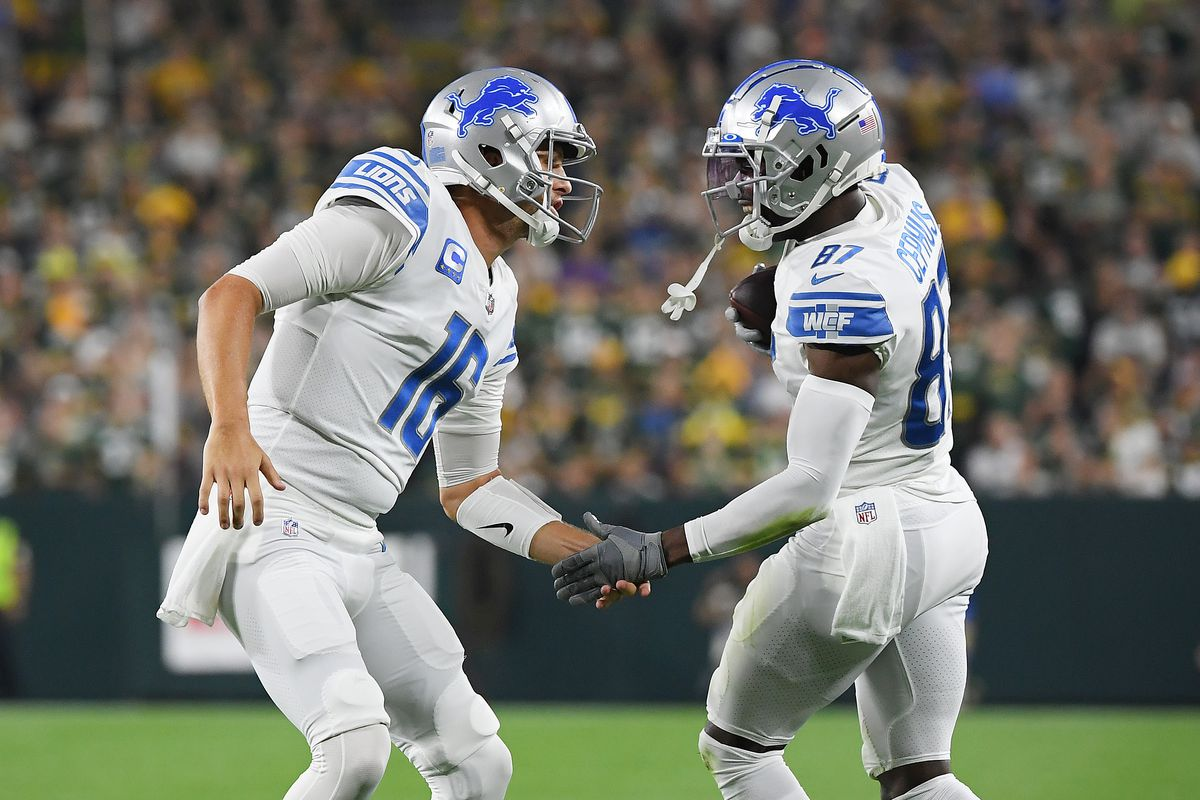 Quintez Cephus #87 of the Detroit Lions celebrates a touchdown with teammate Jared Goff #16 during the first half against the Green Bay Packers at Lambeau Field on September 20, 2021 in Green Bay, Wisconsin.