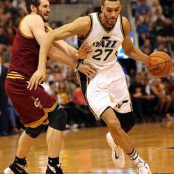 Utah Jazz center Rudy Gobert moves around Cleveland Cavaliers forward Kevin Love during a basketball game at the Vivant Arena in Salt Lake City on Monday, March 14, 2016.