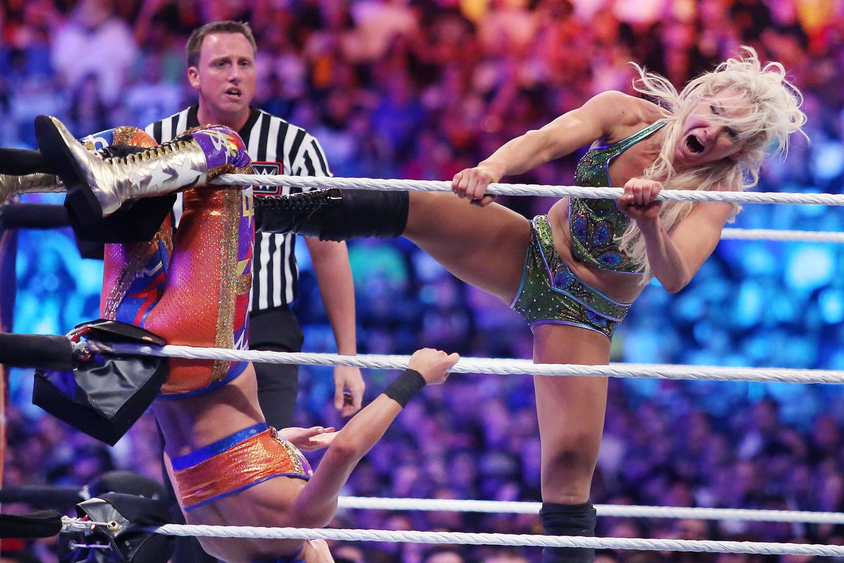 Charlotte Flair, right, kicks Bayley during WrestleMania 33 on Sunday, April 2, 2017 at Camping World Stadium in Orlando, Fla.