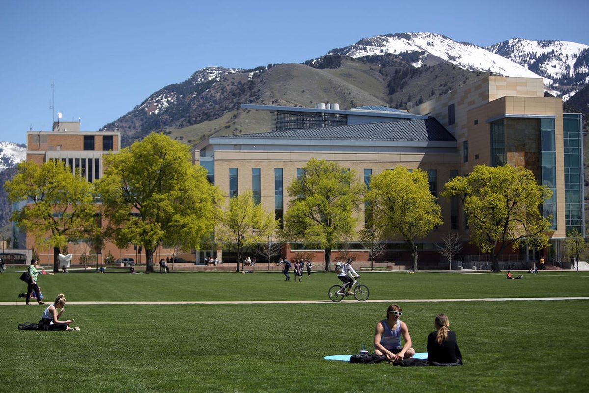 People hang out on the quad in front of the Agricultural Sciences building at Utah State University in Logan on Wednesday, April 20, 2016.