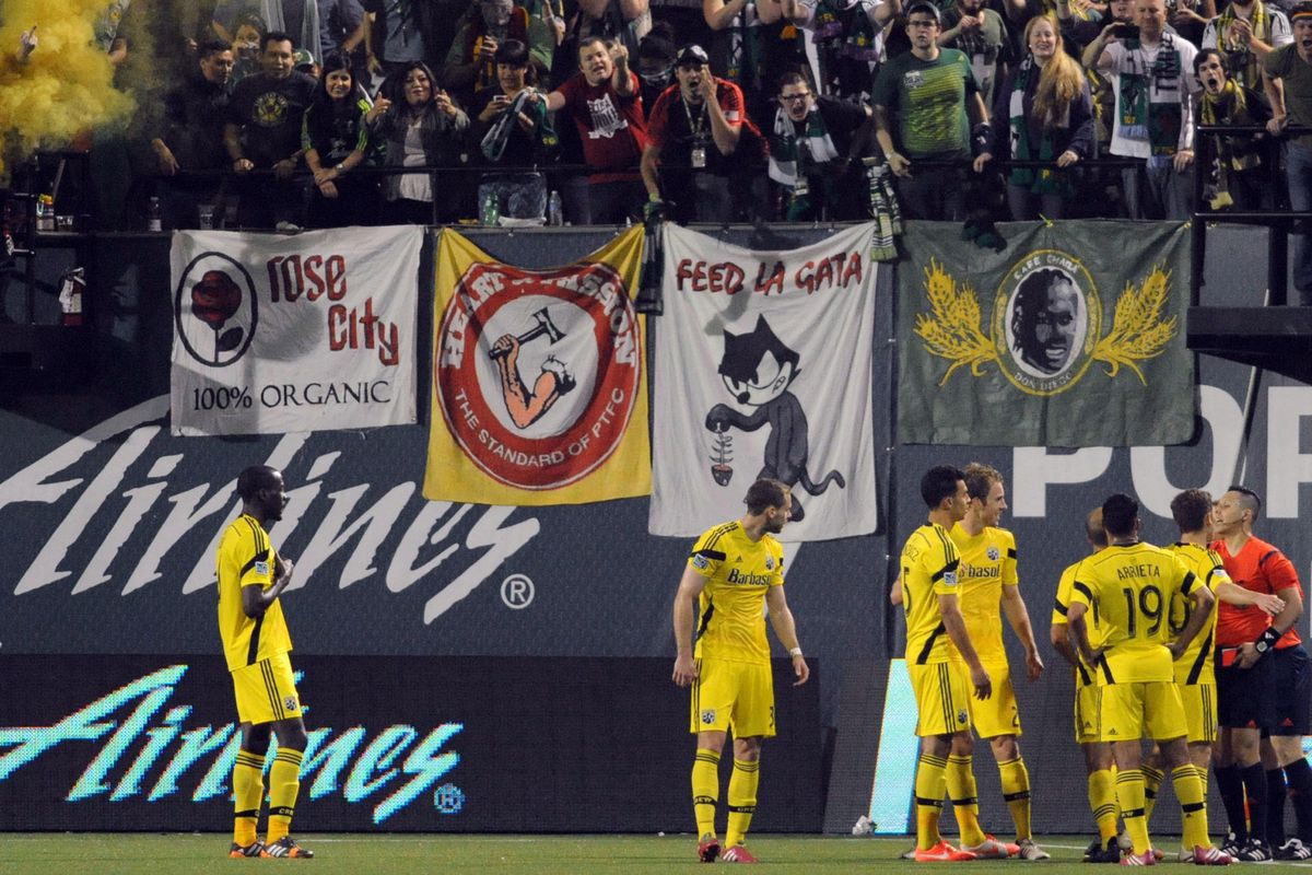Crew players argue with the linesman for a offside call, but the Timbers' final goal stands.