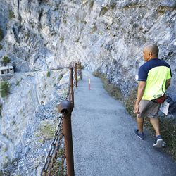 Keenan Adcock, 51, hikes the Timpanogos Cave National Monument trail for the 100th time this season with ranger Cami McKinney on Wednesday, Aug. 31, 2016, in American Fork. Adcock underwent open-heart surgery to replace an aortic valve. The 1 ½ mile trail ascends 1,000 feet to the cave entrance.