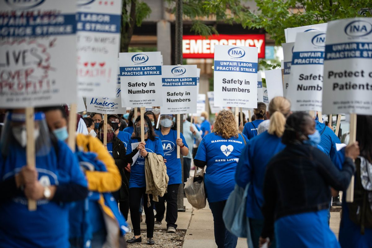 The Illinois Nurses Association marches outside University of Illinois Hospital on the first day of the strike Saturday morning, Sept. 12, 2020.