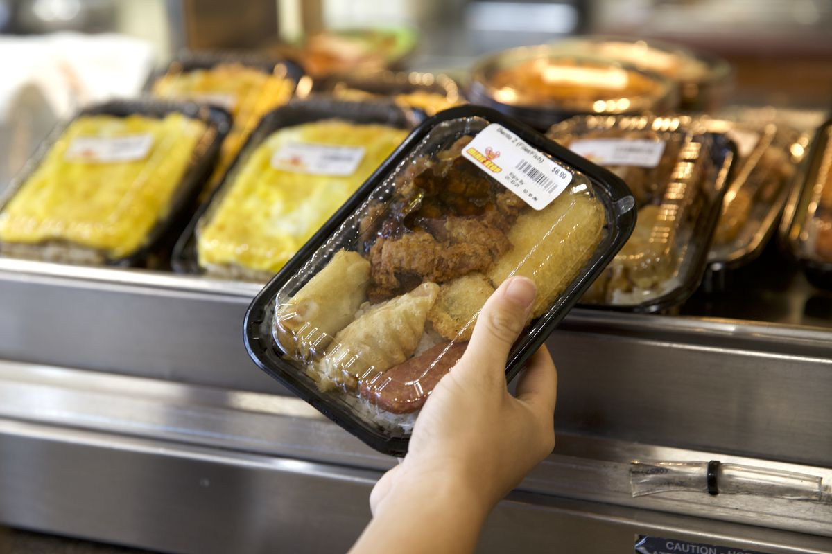 a takeout container full of hot food.