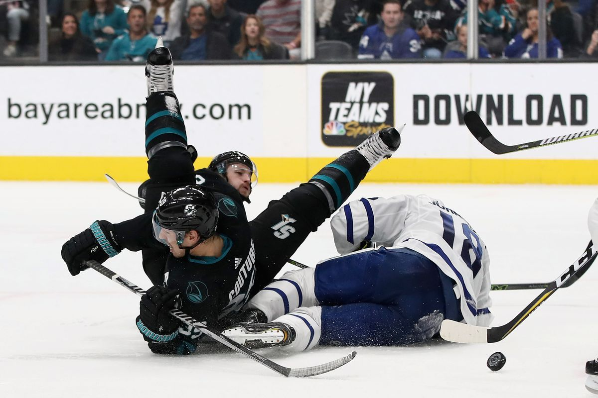 SAN JOSE, CA - NOVEMBER 15: Logan Couture #39 of the San Jose Sharks collides with Andreas Johnsson #18 of the Toronto Maple Leafs at SAP Center on November 15, 2018 in San Jose, California.
