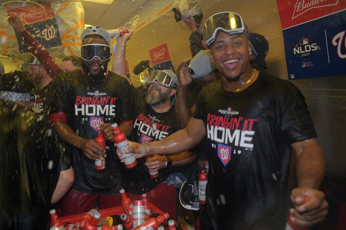 Washington Nationals celebrate in the locker room after they defeat the Los Angeles Dodgers in game 5 of the National League Division Series at Nationals Stadium in Washington, CA on October 9, 2019.