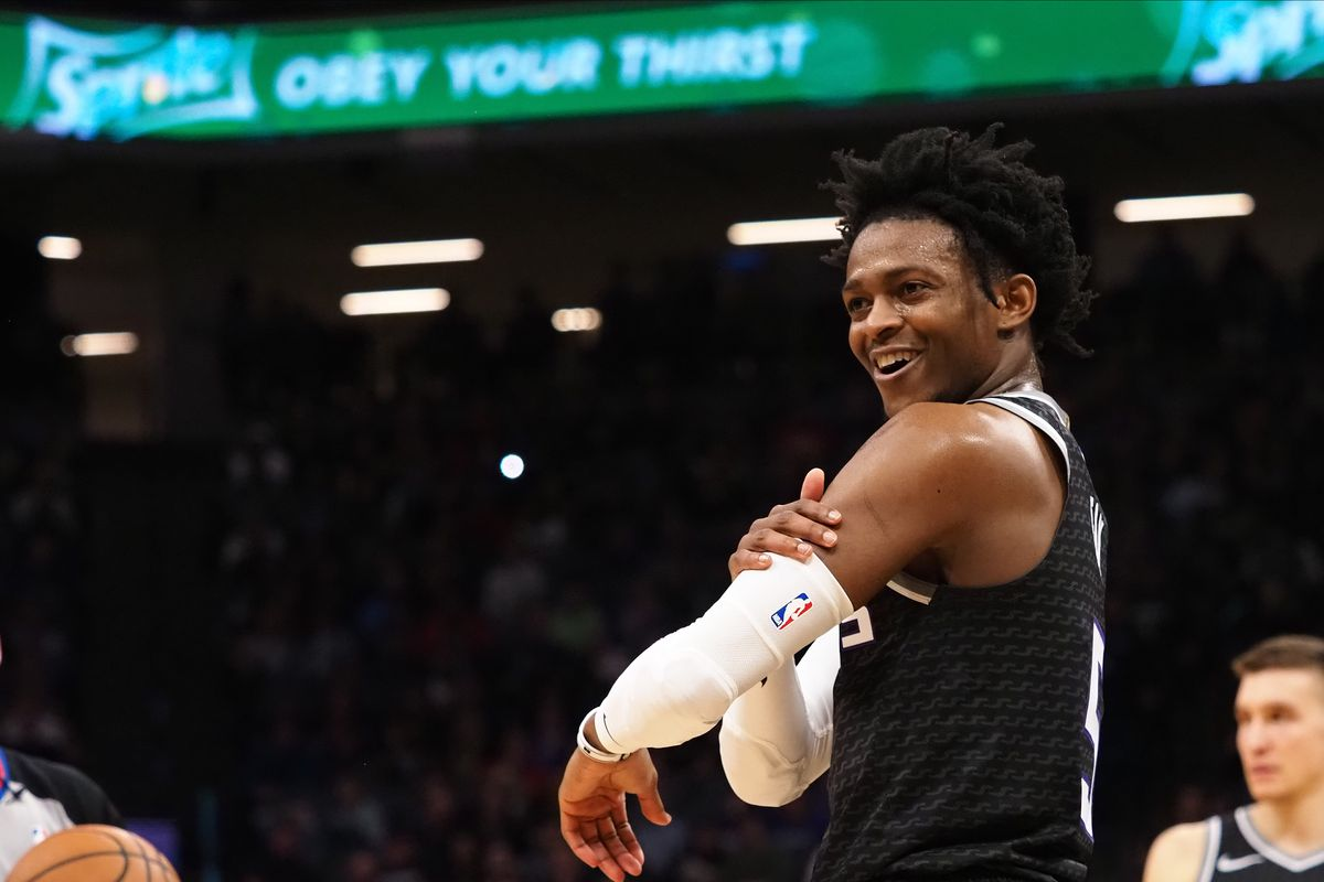 Sacramento Kings guard De'Aaron Fox smiles towards the Memphis Grizzlies bench after being fouled during the second quarter at Golden 1 Center.