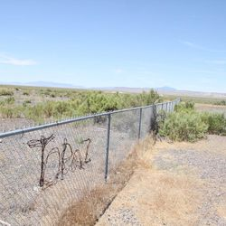 """Little remains of the World War II Japanese-American Topaz Internment Camp. Here, the word """"Topaz"""" spelled into the fence in barbed wire can be seen at the memorial site just outside of the camp."""