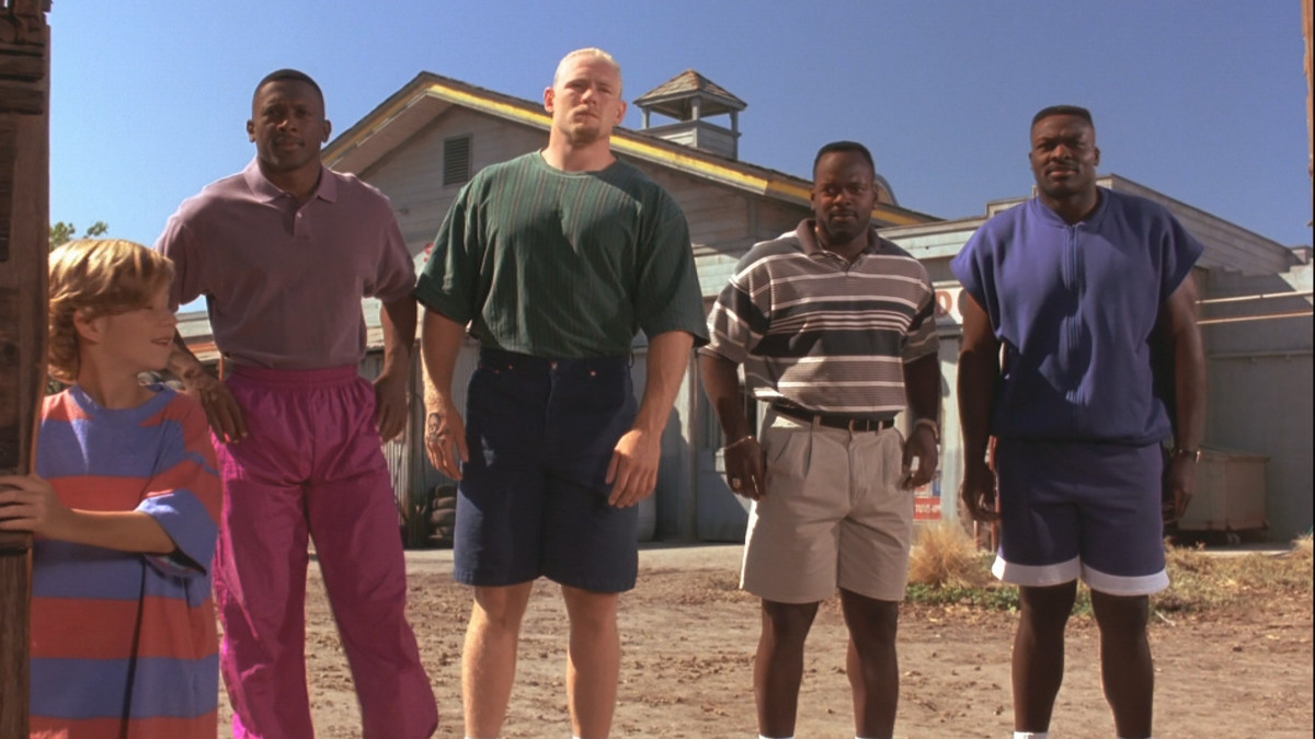 Little Giants picture of Tim Brown, Steve Emtman, Emmit Smith, and Bruce Smith