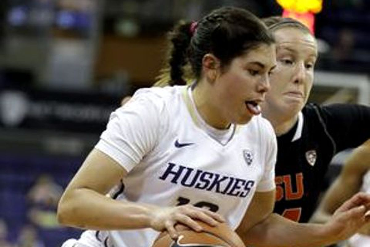 Washington's Kelsey Plum drives past Oregon St.'s Ali Gibson, and the Huskies drove to victory over the Beavers.