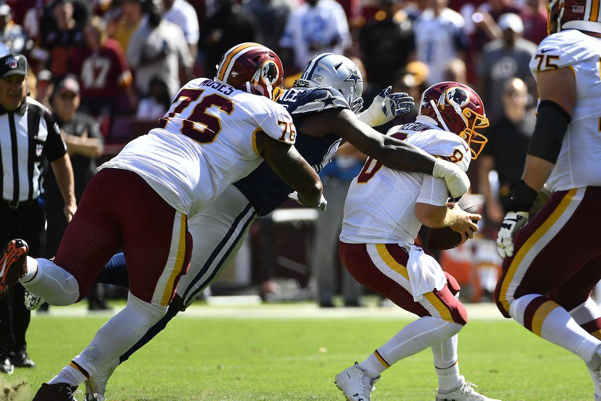 Dallas Cowboys defensive end Demarcus Lawrence sacks Washington quarterback Case Keenum during the second half at FedExField.