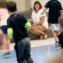 First-grade teacher Chris Strong watches her students take a taekwondo class at South Jordan Elementary School on Wednesday, June 8, 2016.