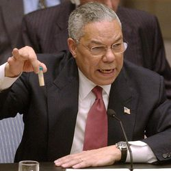 FILE - Secretary of State Colin Powell holds up a vial he said could contain anthrax as he presents evidence of Iraq's alleged weapons programs to the United Nations Security Council in this Feb. 5, 2003 file photo. Israeli Prime Minister Benjamin Netanyahu's use of a cartoon-like drawing of a bomb to convey a message over Iran's disputed nuclear program this week, follows in a long and storied tradition of leaders and diplomats using props to make their points at the United Nations.